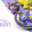Happy Easter yellow and purple mauve lilac theme easter table place setting, with sample greeting or copy space for your text here.
