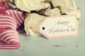 Happy Mothers Day white roses gift on vintage background