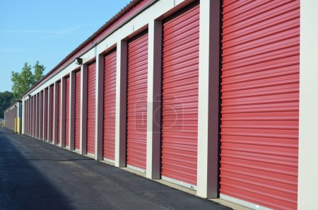 Photo for A row of secure and locked storage unit doors. - Royalty Free Image