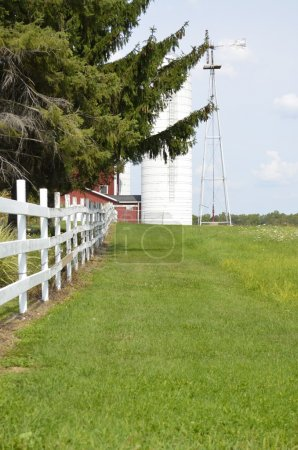 Country fence dividing pastures on a rural Michigan farm