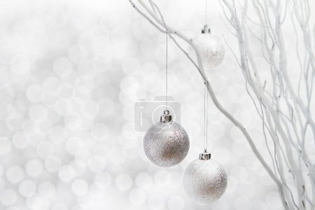 Silver christmas balls on sparkly background