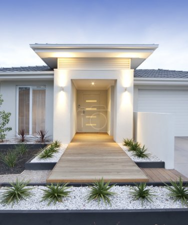 Photo for Facade and entry to a contemporary white rendered home in Australia - vertical - Royalty Free Image