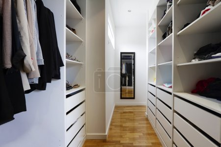 Photo for Contemporary spacious walk in wardrobe in a modern home - Royalty Free Image