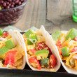 Tacos filled with migas, a Tex-Mex dish of eggs sc...