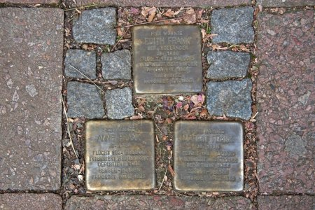 Amsterdam, Netherlands - November 21, 2010: Stumbling Stones remind the stay of the Frank family to Pastor Platz 1 in Aachen, Germany.