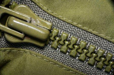 macro of green plastic zipper