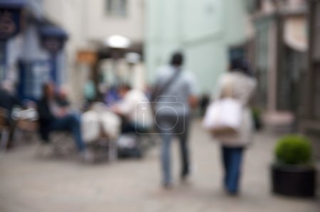 Out of focus shoppers in outdoor mall