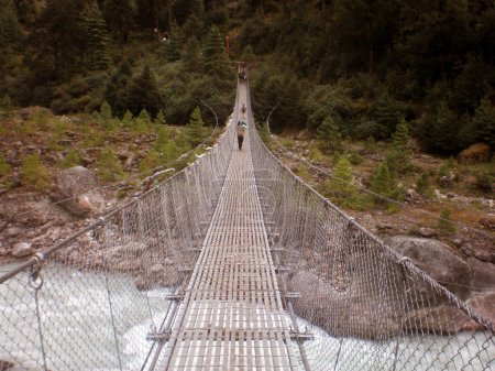 Suspension bridge across the river on the trail to Mt. Everest, Nepal