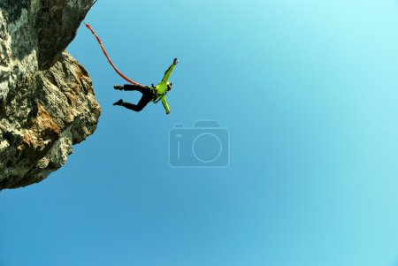 Photo for Jump off a cliff with a rope. - Royalty Free Image