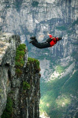 BASE jump off a cliff.