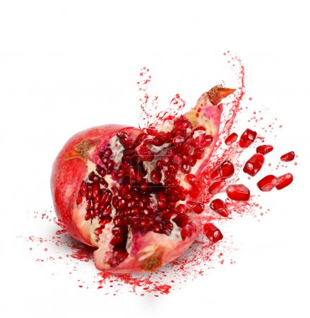 Photo for Falling down ripe pomegranate with cracks and splashes of juice and seeds on white background - Royalty Free Image