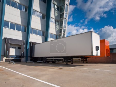 Photo for Red and White Trailer in Front of Docking Bay ready for Transport - Royalty Free Image