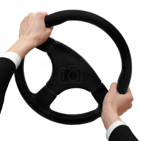 Hands on a steering wheel turn to the left isolated on a white background