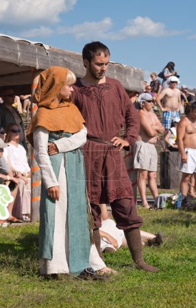 Unidentified young couple in medieval clothes at a historical re