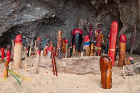 Wooden phalluses in Princess cave. Railay. Thailand