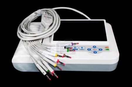 ECG machine isolated on blac...