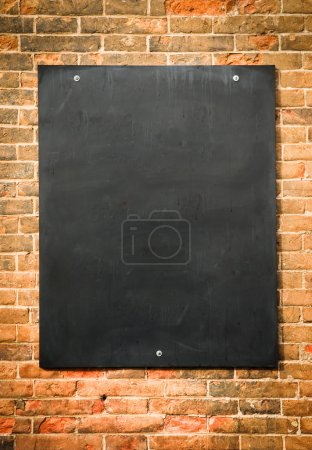 Photo for Blank blackboard at a brick wall - nice background with space for text - Royalty Free Image