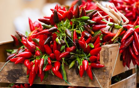 bunch of red hot chili pepper at market
