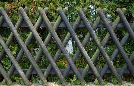 Dark decorative wooden fence