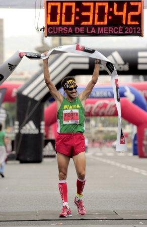 Athlete Roger Roca wins La Cursa de la Merce