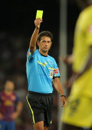 Referee Turienzo Alvarez delivers yellow