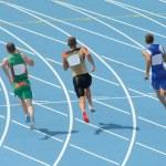 Постер, плакат: Athletes running on track