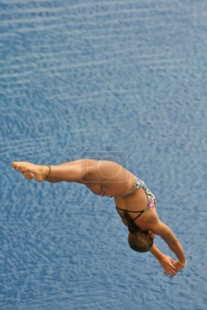 Swimmer launched into water in a diving competitio...