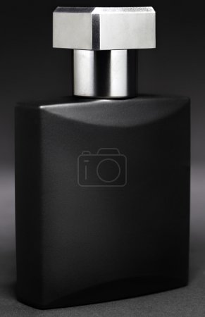 High contrast shot of an aftershave fragrance. The...