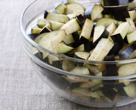 Sliced eggplant in a glass bowl