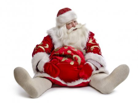Photo for Hilarious and funny Santa Claus sits on a white background - Royalty Free Image