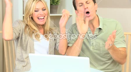 Young Couple Having Success Online