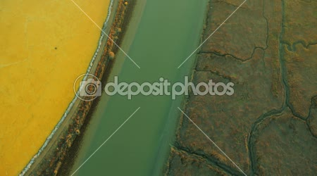 Aerial view of various rich minerals in salt ponds