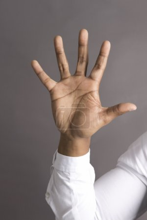 Photo for Five Fingers on one African American Business man Hand - Royalty Free Image