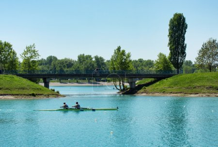 Two young men rowing