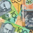 Australian currency background, notes include $100...