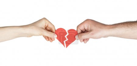 Man and woman hands holding broken heart