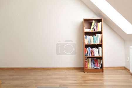 Photo for Bookcase in empty room - Royalty Free Image