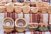 Handmade ceramics with traditional patterns at handicraft market