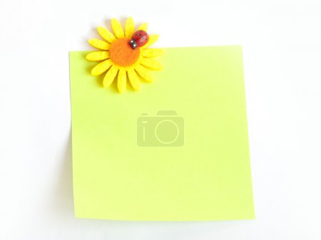 paper note with pin flower and ladybug