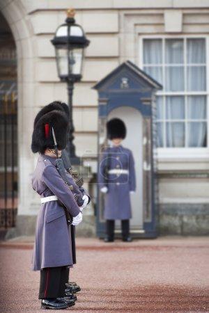 Grenadier guards wearing winter greatcoats
