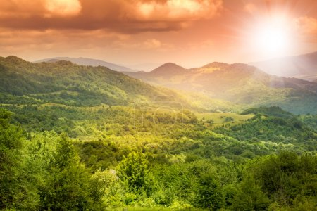 bright stunning beautiful sunset in the mountain valley