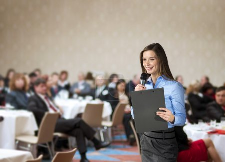 Photo for Beautiful business woman is speaking on conference. - Royalty Free Image