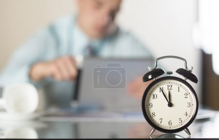 Photo for Businessman in office has problem with deadline - Royalty Free Image