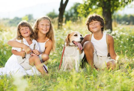 Happy kids with dog