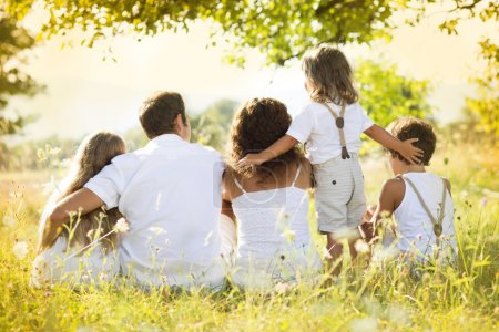Photo for Happy young family spending time outdoor on a summer day - Royalty Free Image