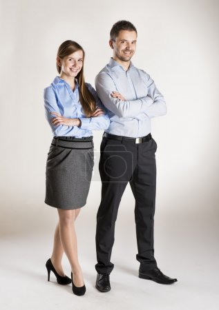 Photo for Successful business couple is standing in studio - Royalty Free Image