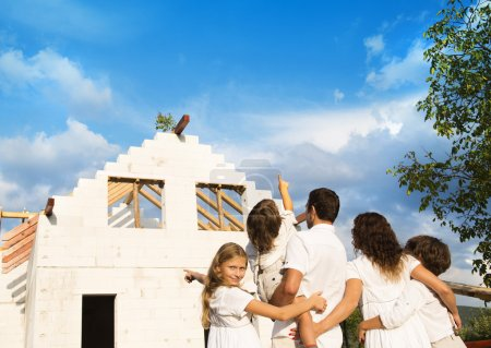 Photo for Happy and big family builds a new house for living - Royalty Free Image