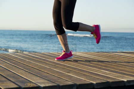 Photo for Running woman. Female runner jogging during outdoor workout on beach. - Royalty Free Image