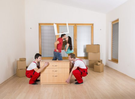 Photo for Movers in new house with young family - Royalty Free Image