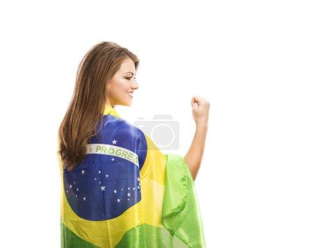 Foto de Aficionado al deporte femenino hermoso con la bandera brasileña aislada sobre fondo blanco - Imagen libre de derechos